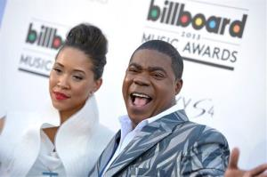 Megan Wollover, left, and host Tracy Morgan arrive at the Billboard Music Awards at the MGM Grand Garden Arena on Sunday, May 19, 2013 in Las Vegas.