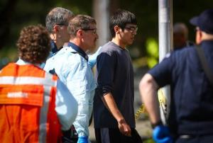Jon Meis is taken from the scene by medics at Seattle Pacific University on Thursday. He stopped the shooter.