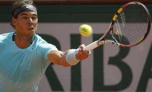 Spain's Rafael Nadal returns the ball during the final of the French Open tennis tournament against Serbia's Novak Djokovic at the Roland Garros stadium, in Paris, France, Sunday, June 8, 2014.