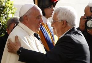 Pope Francis welcomes Palestinian President Mahmoud Abbas, right, as he arrives at the Vatican, Sunday, June 8, 2014..