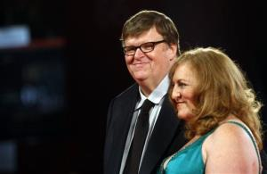 On Sept. 6, 2009, director Michael Moore and wife Kathleen Glynn arrive for the premiere of the film Capitalism: a Love Story at the 66th edition of the Venice Film Festival in Venice, Italy.