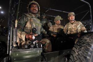 Pakistan army troops arrive at Karachi airport following an attack by unknown gunmen disguised as police guards who stormed a terminal used for VIPs and cargo, Sunday, June 8, 2014, in Pakistan.