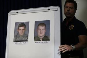 Pictures of Las Vegas Metropolitan Police Officers Alyn Beck, left, and Igor Soldo are seen at a news conference, June 8, 2014 in Las Vegas. They were killed in an ambush while eating lunch.