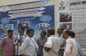College staff working at VNR Vignana Jyothi Institute of Engineering and Technology, gather around in the college premises on the outskirts of Hyderabad, India, Monday, June 9, 2014.