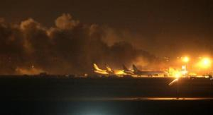 Fire illuminates the sky above the Jinnah International Airport in Karachi where security forces were fighting with attackers Sunday night, June 8, 2014, in Pakistan.