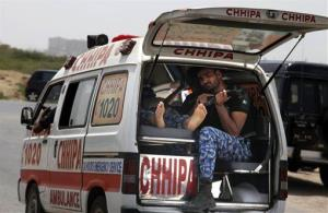An ambulance rushes to a hospital after gunmen attacked a training center for airport security personnel in Karachi, Pakistan today.