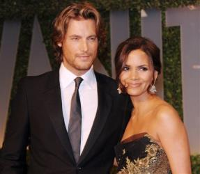 In this Feb. 22, 2009 file photo, actress Halle Berry, right, and Gabriel Aubry arrive at the Vanity Fair Oscar party in West Hollywood, Calif.