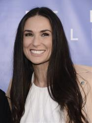 Actress Demi Moore attends the grand opening of De Re Gallery on Thursday, May 15, 2014 in West Hollywood, Calif.