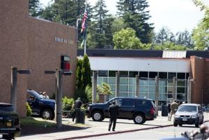Officials work at the scene of a shooting at Reynolds High School Tuesday in Troutdale, Ore.