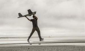 An AeroVironment Puma drone getting launched.