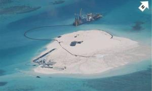 A Chinese vessel is used to expand structures and land on the Johnson Reef, called Mabini by the Philippines and Chigua by China, at the Spratly Islands at South China Sea, Philippines.