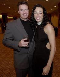 Six-time Olympic gold medalist swimmer Amy Van Dyken and her future husband, Denver Broncos punter Tom Rouen, pose before going into the Colorado Sports Hall of Fame dinner in 2001.