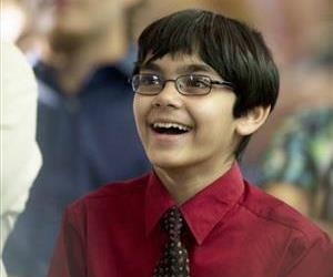 Tanishq Abraham, then-9, smiles as he and other students are inducted into the International Honor Society, Phi Theta Kappa at American River College in Sacramento, Calif, May 3, 2013.