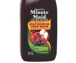 The front of a bottle of Minute Maid Pomegranate Blueberry beverage.