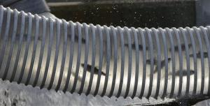In this photo taken Friday, May 9, 2014, young Chinook salmon move through a plastic pipe as they are loaded into a tanker truck at the Nimbus Fish Hatchery in Rancho Cordova, Calif.