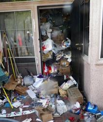 Junk stacked inside the home of a Las Vegas hoarder.