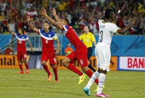 United States' John Brooks (6) celebrates with teammates after scoring his side's second goal during the group G World Cup soccer match between Ghana and the United States at the Arena das Dunas.