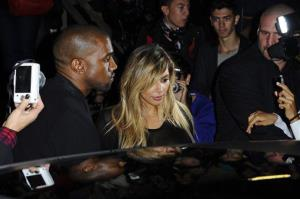 In this Sunday, Sept. 29, 2013 file photo, Kanye West, left, and Kim Kardashian leave after attending Givenchy's ready-to-wear Spring/Summer 2014 fashion collection in Paris.