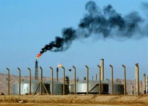 In this Monday, Oct. 6, 2003 file photo, an oil refinery is seen in the city of Beiji, home to Iraq's largest oil refinery.