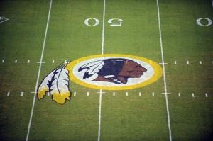 In this Aug. 28, 2009, file photo, the Washington Redskins logo is displayed at midfield before the start of a preseason game in Landover, Md.