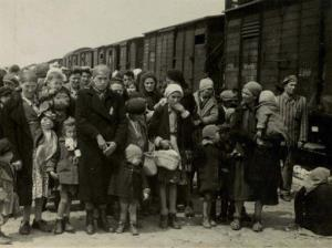 In this 1944 photo provided by Yad Vashem Photo Archives, Jewish women and children deported from Hungary line up at Auschwitz.