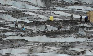 The Joint Task Force-Alaska Team from Joint Base Elmendorf-Richardson and Fort Wainwright recovers debris on Colony Glacier near Anchorage, Alaska.