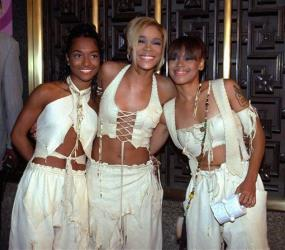 In this Sept. 7, 1995, photo, the band TLC, left to right, Rozanda Chilli Thomas, Tionne T-Boz Watkins and Lisa Left Eye Lopes, pose before the start of the 12th Annual MTV Video Music Awards.