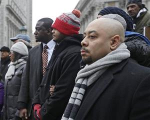 Three of the Central Park Five are seen during a rally in Foley Square in New York on the day of a court hearing last year.