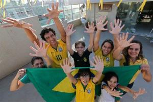 Members of the Silva family pose for a photo in their home in Brasilia, Brazil, Thursday, June 19, 2014.