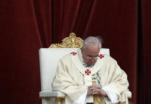 Pope Francis celebrates a mass outside  St. John at the Lateran Basilica to mark the feast of the Body and Blood of Christ, in Rome, Thursday, June 19, 2014.