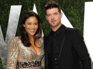 In this Feb. 24, 2013 file photo, Paula Patton and Robin Thicke arrive at the 2013 Vanity Fair Oscars Viewing and After Party at the Sunset Plaza Hotel in West Hollywood, Calif.