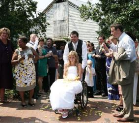 Rachelle Friedman, a bride paralyzed last year, and husband Chris Chapman, leave their wedding reception on Friday, July 22, 2011, in Pittsboro, NC.