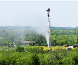In this April 19, 2013 photo, vapor shoots from a natural gas well owned by Eagle Ridge Operating LLC, in Denton, Texas.