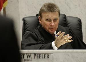 Judge Robert Peeler, shown on April 15, 2014, in Lebanon, Ohio, is among a growing number of judges and corrections officials across the country fighting heroin needles with treatment needles.