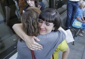 Kate Kelly receives a hug from a supporter after walking to the Church Office Building of the Church of Jesus Christ of Latter-day Saints in Salt Lake City.