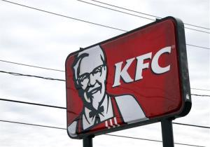 In this  Friday, Jan. 31, 2014, photo, a KFC sign hangs in Saugus, Mass.