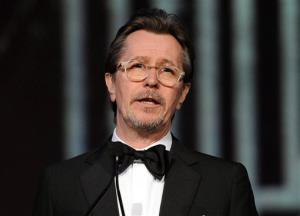 This Jan. 4, 2014 file photo shows actor Gary Oldman speaking at the Palm Springs International Film Festival Awards Gala at the Palm Springs Convention Center in Palm Springs, Calif.