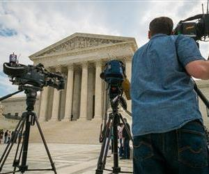 Videojournalists set up outside of the U.S. Supreme Court, April 22, 2104.