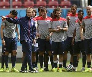 United States' head coach Jurgen Klinsmann, center left, instructs his players during a training session in Recife, Brazil, June 25, 2014.