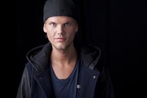 In this Aug. 30, 2013 file photo, Swedish DJ, remixer and record producer Avicii poses for a portrait in New York.