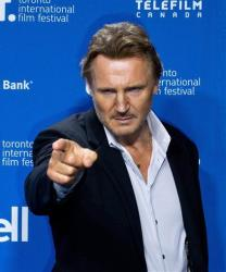 Liam Neeson plays it up for the camera during a photo call for Third Person at the 2013 Toronto International Film Festival.