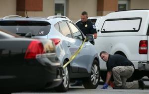 Cobb County police investigate an SUV where a toddler died Wednesday, June 18, 2014, near Marietta, Ga.