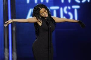 Nicki Minaj accepts the award for best female hip hop artist at the BET Awards at the Nokia Theatre on Sunday, June 29, 2014, in Los Angeles.