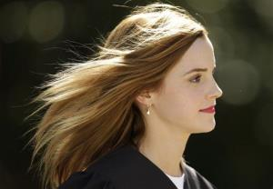 Actress Emma Watson walks between buildings following commencement services on the campus of Brown University, Sunday, May 25, 2014, in Providence, RI.