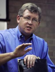 In this Aug. 7, 2008, file photo, US Rep. Frank Lucas, R-Okla., speaks at a town-hall meeting in Guymon, Okla.