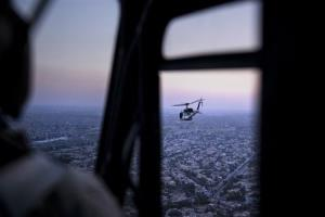 A photo taken on board a helicopter shows a US State Department helicopter flying over the Iraqi capital Baghdad carrying John Kerry Monday, June 23, 2014.