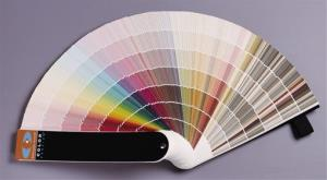 This image provided by Benjamin Moore shows a fan deck of paint colors that consumers can look through at a hardware store to help them decide what color paint to buy.