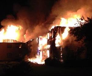 Flames consume a building at Lakeview Meadows apartments Monday, June 16, 2014 in Battle Creek, Mich.  Authorities say residents escaped safely during a fire at the senior citizens apartment complex that prompted an evacuation of more than 100 people.