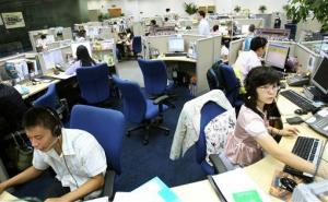 Chinese employees work in cubicles at the Hewlett-Packard call center in Dalian, northeastern China's Liaoning province, on Sept. 24, 2007.