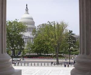 The U.S. Capitol building is seen through the columns on the steps of the Supreme Court, Monday, May 5, 2014, in Washington.